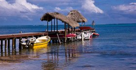 pier-and-speed-boats-ambergris-caye