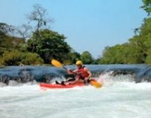 We teach beginning whitewater kayaking on the Mopan River.